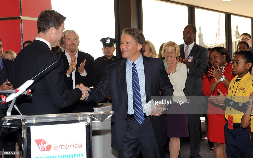 In this handout photo provided by Virgin America Airlines, David Cush Virgin America president and CEO is welcomed to the podium by Bill Baroni, Deputy Executive Director of the Port Authority of New York & New Jersey during celebration of launch of its new service to Newark, New Jersey from San Francisco and Los Angeles, at Newark Liberty International Airport (EWR), April 9, 2013 at Newark, New Jersey. Branson joined local flyers for a pre-flight Google+ 'Fly Like a Boss' hangout to discuss how technology is changing business and travel.