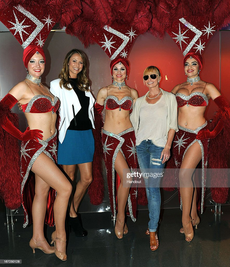 In this handout photo provided by Virgin America Airlines, Las Vegas showgirls poses with actresses Jaime Pressly (2nd R) and Stacy Kiebler (2nd L) in the airline's newly opened domestic lounge Ð The Loft at LAX (at Los Angeles International Airport's (LAX) Terminal 3), Monday, April 22, 2013 in Los Angeles. The Virgin America Loft extends the airline's signature cabin experience into the airport space with WiFi and amenities like a cocktail bar with an artisanal cocktail selection. The airline celebrates the new three daily roundtrip flights from LAX-LAS, which will add to the airline's existing service from San Francisco International Airport (SFO) to LAS and from New York's Kennedy International Airport (JFK) to LAS.