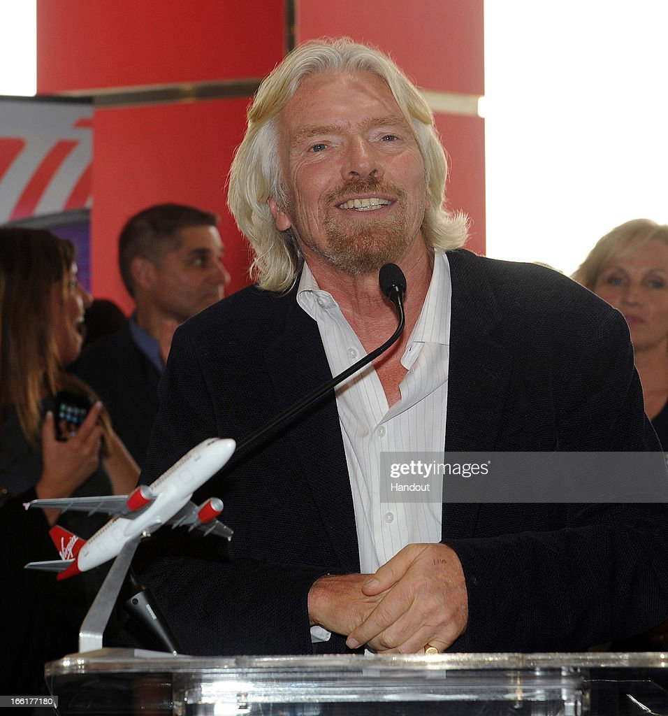 In this handout photo provided by Virgin America Airlines, Virgin Group Founder Sir Richard Branson speaks to guests during celebration of the launch of its new service to Newark, New Jersey from San Francisco and Los Angeles, at Newark Liberty International Airport (EWR), April 9, 2013 at Newark, New Jersey. Branson joined local flyers for a pre-flight Google+ 'Fly Like a Boss' hangout to discuss how technology is changing business and travel.