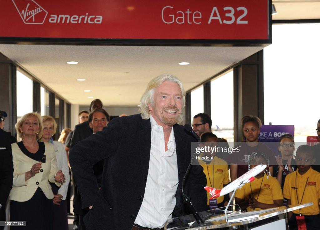 In this handout photo provided by Virgin America Airlines, Virgin Group Founder Sir <a gi-track='captionPersonalityLinkClicked' href=/galleries/search?phrase=Richard+Branson&family=editorial&specificpeople=220198 ng-click='$event.stopPropagation()'>Richard Branson</a> speaks to guests during celebration of the launch of its new service to Newark, New Jersey from San Francisco and Los Angeles, at Newark Liberty International Airport (EWR), April 9, 2013 at Newark, New Jersey. Branson joined local flyers for a pre-flight Google+ 'Fly Like a Boss' hangout to discuss how technology is changing business and travel.