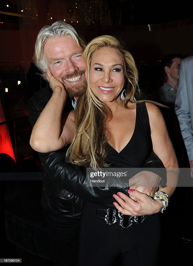 In this handout photo provided by Virgin America Airlines, Virgin Group Founder Sir <a gi-track='captionPersonalityLinkClicked' href=/galleries/search?phrase=Richard+Branson&family=editorial&specificpeople=220198 ng-click='$event.stopPropagation()'>Richard Branson</a> shares a hug with Adrienna Maloof during celebration of launch of new nonstop service from Los Angeles International (LAX) to Las Vegas McCarran International (LAS) Airports, Monday, April 22, 2013, inside The Chandelier at The Cosmopolitan of Las Vegas. The airline celebrates its new flight service with a launch party at The Chandelier at The Cosmopolitan of Las Vegas. The new three daily roundtrip flights from LAX to LAS will add to the airline's existing service from San Francisco and New York to Las Vegas.