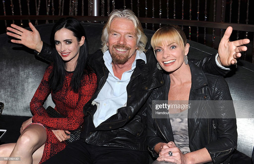 In this handout photo provided by Virgin America Airlines, Virgin Group Founder Sir <a gi-track='captionPersonalityLinkClicked' href=/galleries/search?phrase=Richard+Branson&family=editorial&specificpeople=220198 ng-click='$event.stopPropagation()'>Richard Branson</a> is joined by actress <a gi-track='captionPersonalityLinkClicked' href=/galleries/search?phrase=Jaime+Pressly&family=editorial&specificpeople=211226 ng-click='$event.stopPropagation()'>Jaime Pressly</a> (R) and <a gi-track='captionPersonalityLinkClicked' href=/galleries/search?phrase=Krysten+Ritter&family=editorial&specificpeople=655673 ng-click='$event.stopPropagation()'>Krysten Ritter</a> during the launch of new nonstop service from Los Angeles International (LAX) to Las Vegas McCarran International (LAS) Airport, on April 22, 2013 in Las Vegas, Nevada. The new three daily roundtrip flights from LAX will add to the airline's existing service from San Francisco and New York to Las Vegas McCarran.
