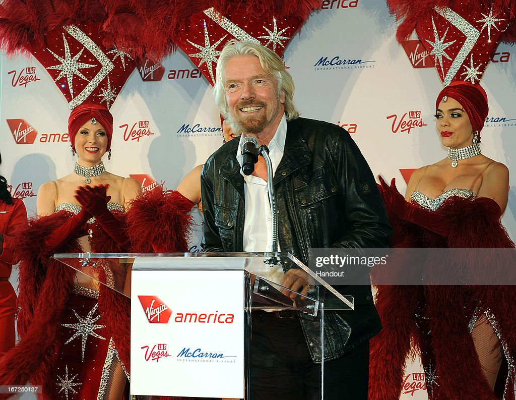 In this handout photo provided by Virgin America Airlines, Virgin Group Founder Sir <a gi-track='captionPersonalityLinkClicked' href=/galleries/search?phrase=Richard+Branson&family=editorial&specificpeople=220198 ng-click='$event.stopPropagation()'>Richard Branson</a> welcomes guests on Virgin America's inaugural flight guests with a red carpet welcome at Las Vegas McCarran International (LAS) Airport on on April 22, 2013 in Las Vegas, Nevada. To mark the airline's new service from Los Angeles to Las Vegas, the airline hosted an airport welcome with the Las Vegas Convention and Visitors Authority and The Cosmopolitan of Las Vegas that included a custom cocktail bar in the airport arrival gate. The airline celebrates its new service that evening with a launch party at The Chandelier at The Cosmopolitan of Las Vegas. To mark the Vegas expansion, the airline launched a new seat-to-seat cocktail delivery service on flights nationwide, so travelers can send fellow guests onboard a drink and text message via a seatmap on the airline's in-flight entertainment platform. The new three daily roundtrip flights from LAX to LAS will add to the airline's existing service from San Francisco and New York to Las Vegas McCarran.