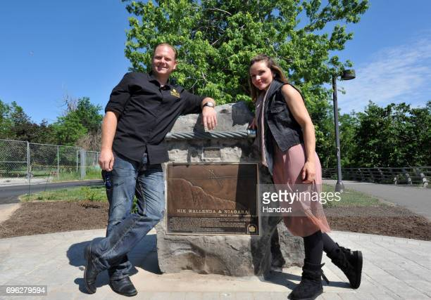 In this handout photo provided by Wallenda Incorporated Nik Wallenda and Erendira Wallenda pose for a photograph beside a commemorative plaque June...