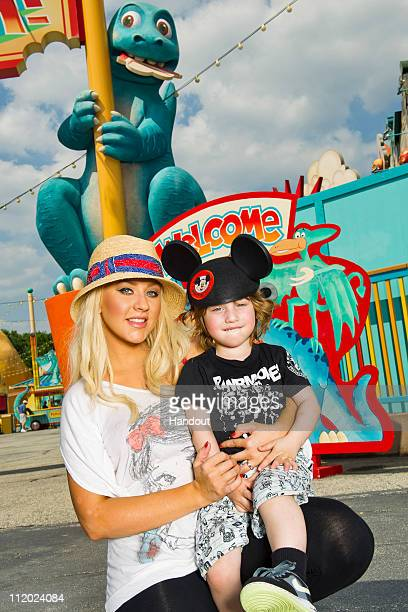 In this handout photo provided by Walt Disney Studios Grammy Awardwinning singer Christina Aguilera poses with her son Max at Disney's Animal Kingdom...