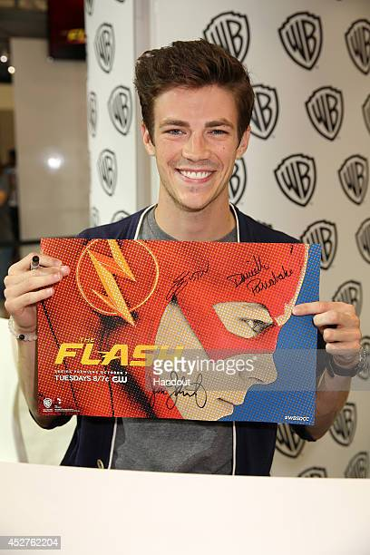 In this handout photo provided by Warner Bros Grant Gustin of 'The Flash' attends ComicCon International 2014 on July 26 2014 in San Diego California