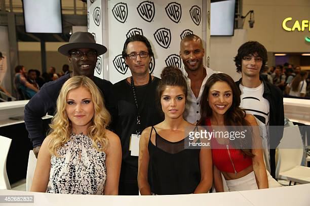 In this handout photo provided by Warner Bros Isaiah Washington executive producer Jason Rothenberg series stars Ricky Whittle Devon Bostick Lindsey...