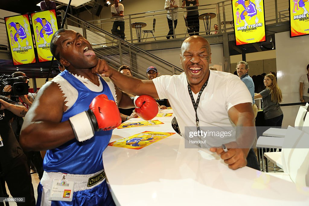 In this handout photo provided by Warner Bros., <a gi-track='captionPersonalityLinkClicked' href=/galleries/search?phrase=Mike+Tyson&family=editorial&specificpeople=194986 ng-click='$event.stopPropagation()'>Mike Tyson</a> of '<a gi-track='captionPersonalityLinkClicked' href=/galleries/search?phrase=Mike+Tyson&family=editorial&specificpeople=194986 ng-click='$event.stopPropagation()'>Mike Tyson</a> Mysteries' attends Comic-Con International 2014 on July 25, 2014 in San Diego, California.