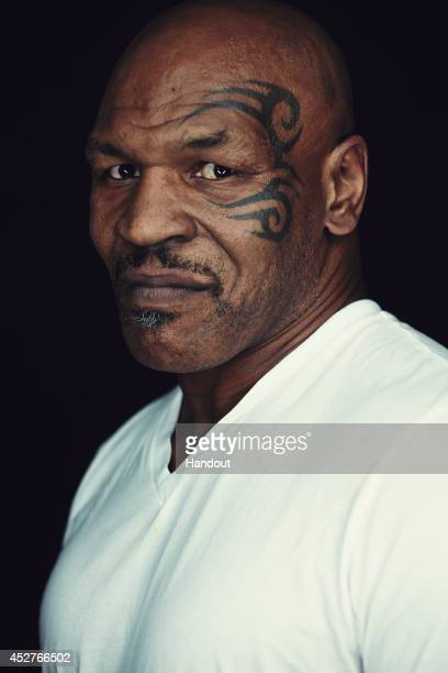 In this handout photo provided by Warner Bros Mike Tyson of 'Mike Tyson Mysteries' attends ComicCon International 2014 on July 26 2014 in San Diego...