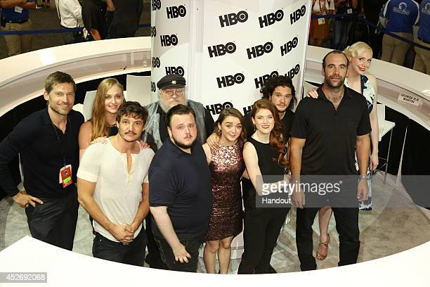 In this handout photo provided by Warner Bros Nikolaj CosterWaldau Sophie Turner and Pedro Pascal author writer and coexecutive producer George R R...