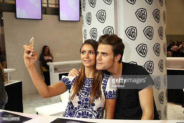 In this handout photo provided by Warner Bros Nina Dobrev and Paul Wesley of 'The Vampire Diaries' attend ComicCon International 2014 on July 26 2014...
