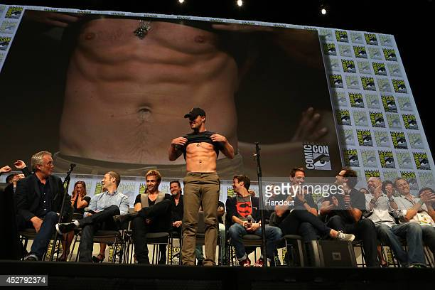In this handout photo provided by Warner Bros Stephen Amell with stars and executive producers from Gotham Constantine The Flash and Arrow attend the...