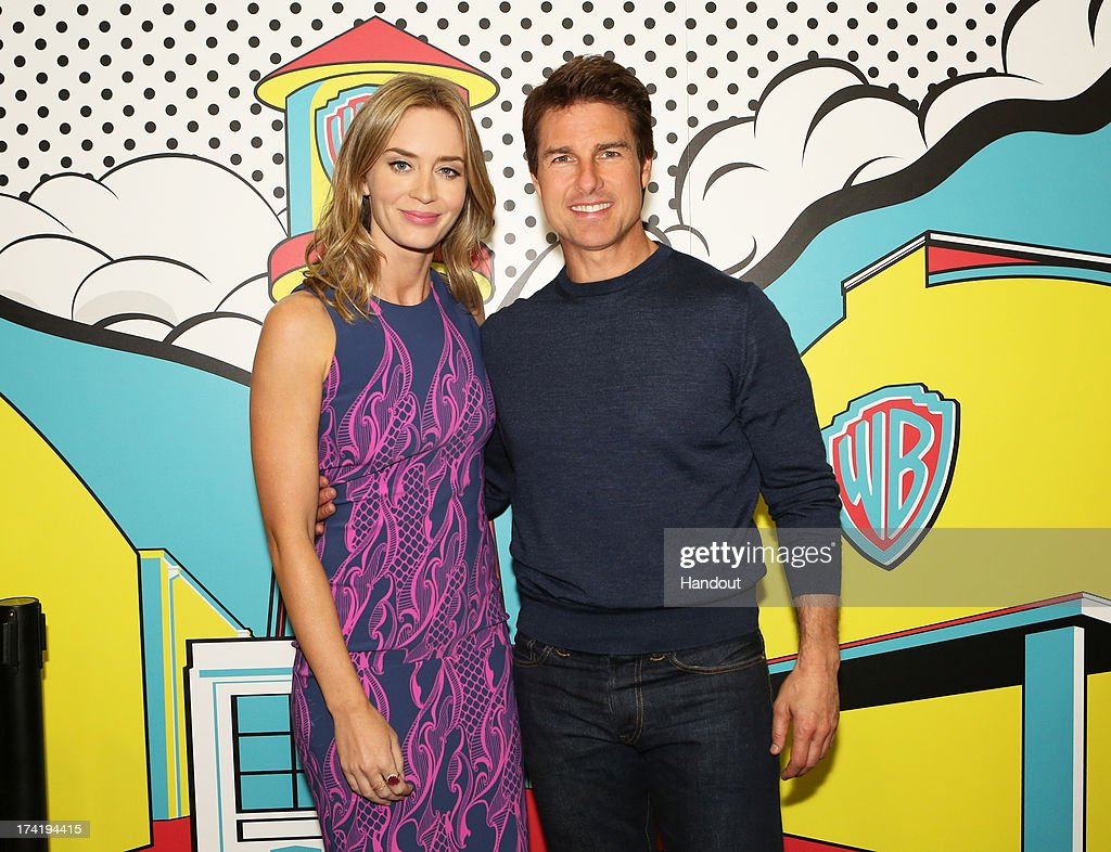In this handout photo provided by WBTV, 'Edge of Tomorrow' stars <a gi-track='captionPersonalityLinkClicked' href=/galleries/search?phrase=Emily+Blunt&family=editorial&specificpeople=213480 ng-click='$event.stopPropagation()'>Emily Blunt</a> and <a gi-track='captionPersonalityLinkClicked' href=/galleries/search?phrase=Tom+Cruise&family=editorial&specificpeople=156405 ng-click='$event.stopPropagation()'>Tom Cruise</a> at the Warner Bros. booth during Comic-Con 2013 on July 20, 2013 in San Diego, California.