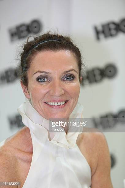 In this handout photo provided by WBTV Game Of Thrones actress Michelle Fairley at the Warner Bros booth to meet fans at the San Diego Convention...