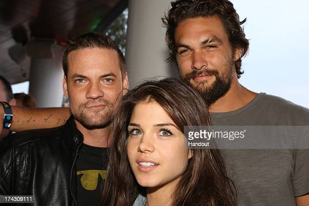In this handout photo provided by WBTV NIKITA's Shane West THE 100's Marie Avgeropoulos and GAME OF THRONES star Jason Momoa at the Warner Bros/DC...