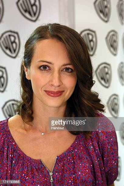 In this handout photo provided by WBTV 'Person of Interest' star Amy Acker attends the Warner Bros booth during ComicCon on July 20 2013 in San Diego...