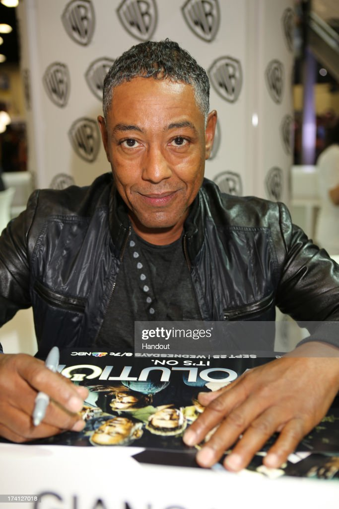 In this handout photo provided by WBTV, REVOLUTION star <a gi-track='captionPersonalityLinkClicked' href=/galleries/search?phrase=Giancarlo+Esposito&family=editorial&specificpeople=725984 ng-click='$event.stopPropagation()'>Giancarlo Esposito</a> (aka Captain Tom Neville) attends the REVOLUTION signing at the Warner Bros. booth at the 2013 San Diego Comic-Con International held at the San Diego Convention Center on July 20, 2013 in San Diego, California.