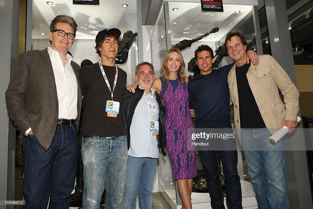In this handout photo provided by WBTV, the 'Edge of Tomorrow' team (L-R) screenwriter Christopher McQuarrie, director Doug Liman, producer Erwin Stoff, actors Emily Blunt, Tom Cruise and Bill Paxton at the Warner Bros. booth during Comic-Con 2013 on July 20, 2013 in San Diego, California.