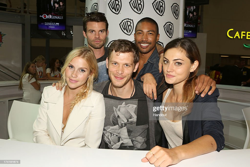In this handout photo provided by WBTV, 'The Originals' cast members (L-R) Claire Holt, Daniel Gillies, Joseph Morgan, Charles Michael Davis and Phoebe Tonkin attend the Warner Bros. booth for Comic-Con on July 20, 2013 in San Diego, California.