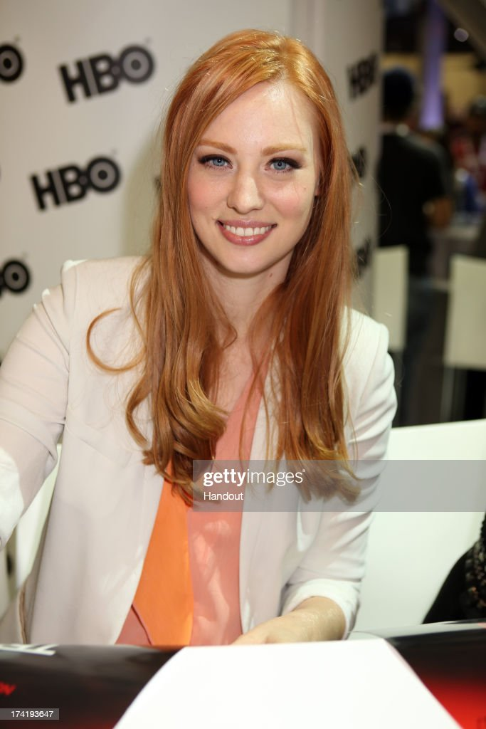 In this handout photo provided by WBTV, 'True Blood' star Deborah Ann Woll attends the Warner Bros. booth during Comic-Con on July 20, 2013 in San Diego, California.