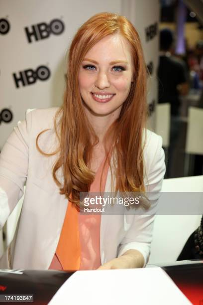In this handout photo provided by WBTV 'True Blood' star Deborah Ann Woll attends the Warner Bros booth during ComicCon on July 20 2013 in San Diego...