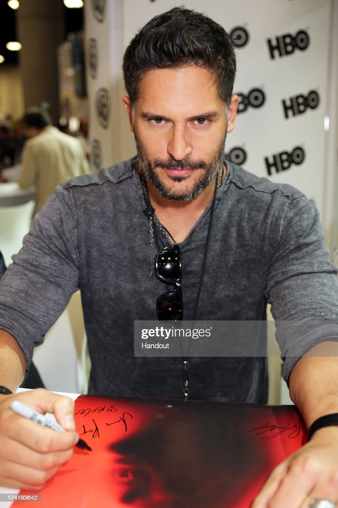 In this handout photo provided by WBTV, 'True Blood' star <a gi-track='captionPersonalityLinkClicked' href=/galleries/search?phrase=Joe+Manganiello&family=editorial&specificpeople=2516889 ng-click='$event.stopPropagation()'>Joe Manganiello</a> attends the Warner Bros. booth during Comic-Con on July 20, 2013 in San Diego, California.