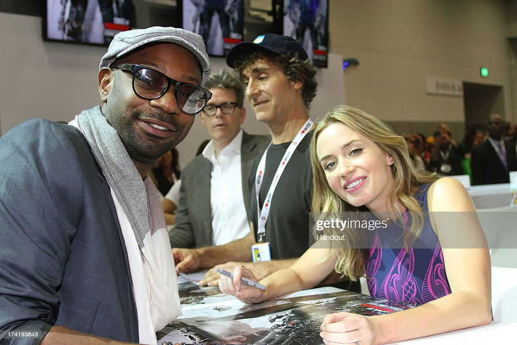 In this handout photo provided by WBTV, 'True Blood' star Nelsan Ellis and 'Edge Of Tomorrow' star Emily Blunt and director Doug Liman attend the Warner Bros. booth during Comic-Con on July 20, 2013 in San Diego, California.