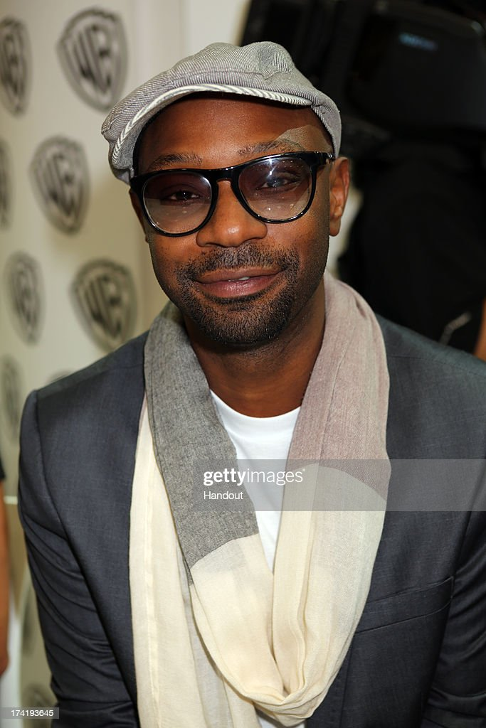 In this handout photo provided by WBTV 'True Blood' star Nelsan Ellis attends the Warner Bros booth during ComicCon on July 20 2013 in San Diego...