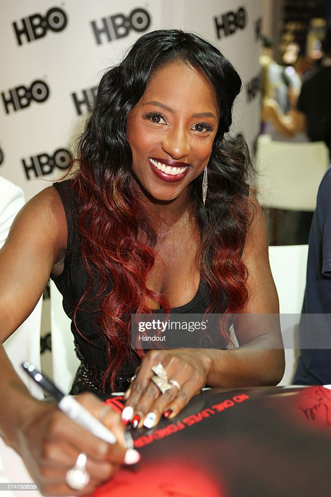 In this handout photo provided by WBTV, 'True Blood' star Rutina Wesley attends the Warner Bros. booth during Comic-Con on July 20, 2013 in San Diego, California.