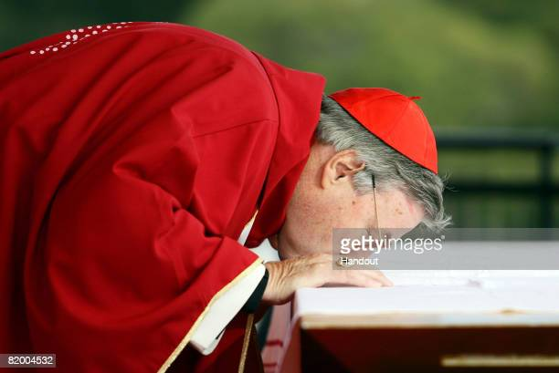 In this handout photo provided by World Youth Day His Eminence Cardinal George Pell Catholic Archbishop of Sydney kisses the altar during the Final...