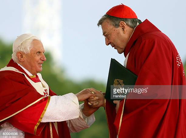 In this handout photo provided by World Youth Day His Holiness Pope Benedict XVI shakes hands with His Eminence Cardinal George Pell Catholic...
