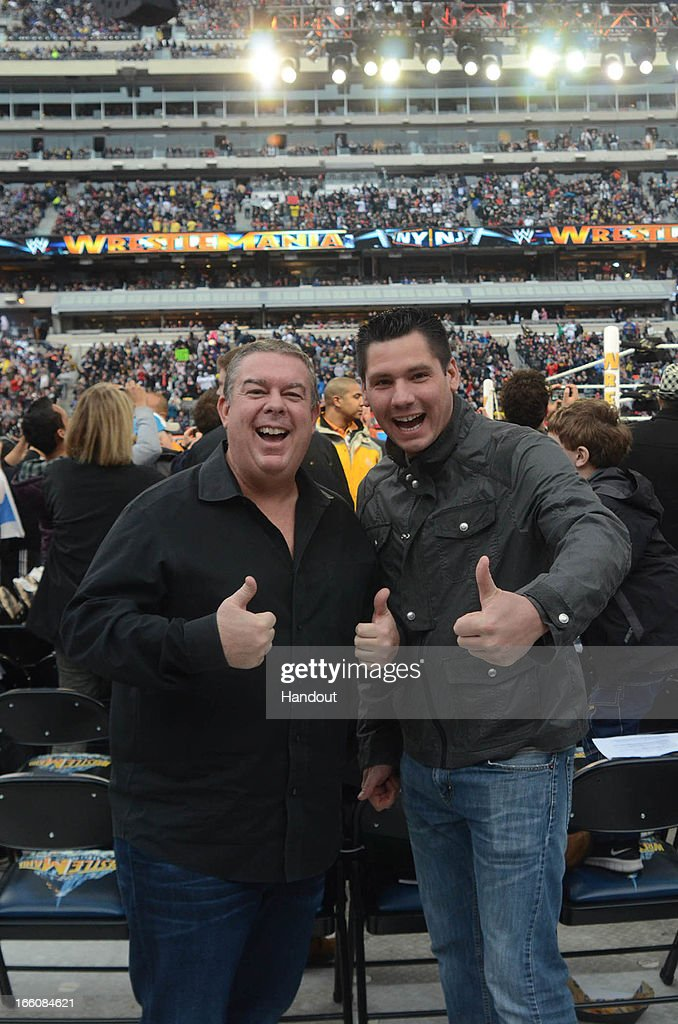 In this handout photo provided by WWE, Inc., Elvis Duran and Alex Carr from 'WW 29' visit MetLife Stadium April 7, 2013 in East Rutherford, New Jersey.
