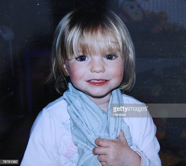 In this handout photo relased September 16 2007 missing child Madeleine McCann smiles The McCann family have returned from Portugal after local...