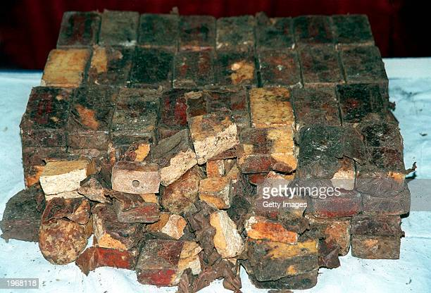 In this handout photo released by Pakistan paramilitary soldiers seized explosive materials are on display May 2 2003 in Karachi Pakistan Six...