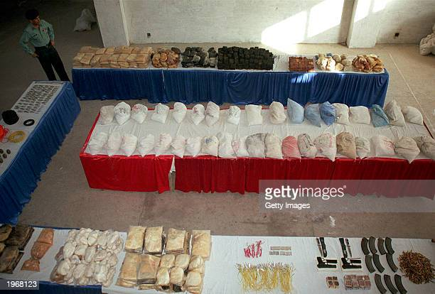 In this handout photo released by Pakistan paramilitary soldiers seized weapons and explosive materials are on display May 2 2003 in Karachi Pakistan...
