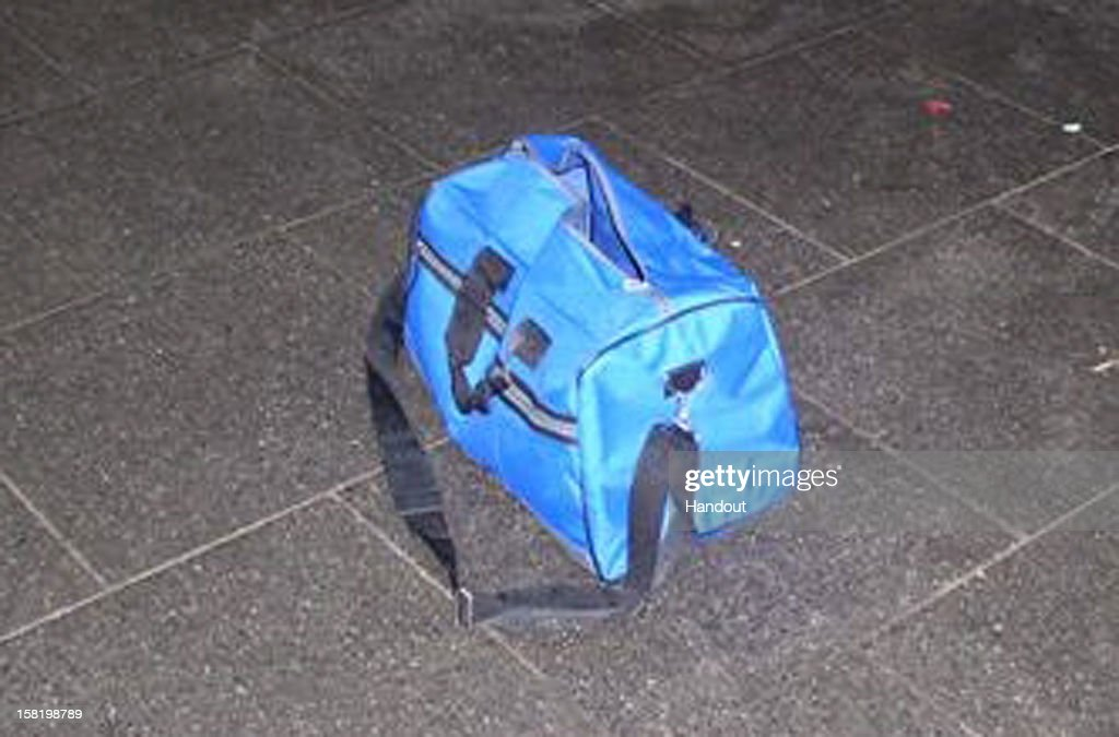 In this handout photo released by Polizei Koeln, a blue bag containing explosives sits on the floor at Bonn central railway station on December 10, 2012 in Berlin, Germany. Police say the bag contains several metal containers filled with an explosive powder, though the bag did not contain detonators. Discovery of the bag led to a total shutdown of the train station for several hours, and police today are investigating who might be responsible for the bag.