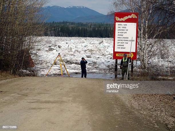 In this handout photo released by the Alaska State Troopers members of the US Geological Survey measure the water level of the flooded Yukon River at...