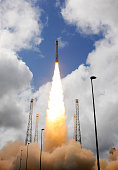 In this handout photo released by the European Space Agency Vega VV04 carrying ESA's experimental spaceplane IXV during liftoff from Europe's...