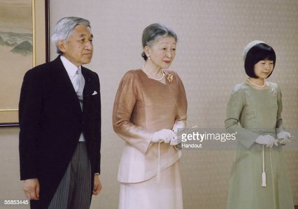 In this Handout Photo released by the Imperial Household Agency Japan's Emperor Akihito Empress Michiko and their daughter Princess Sayako stand...