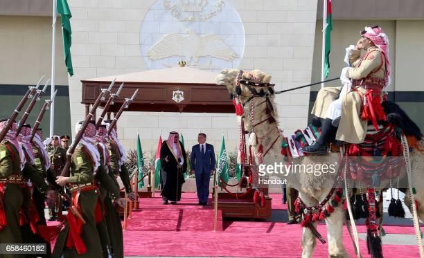 In this Handout photo released by the Jordanian Royal Court King Abdullah II of Jordan and King Salman bin Abdulaziz Al Saud of Saudi Arabia review...