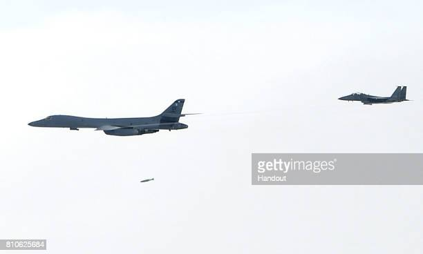 In this handout photo released by the South Korean Defense Ministry A US Air Force B1B Lancer bomber drops a bomb during a South KoreaUS joint live...