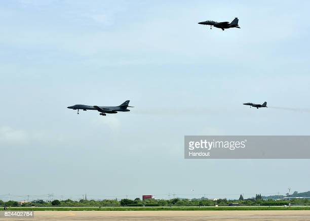 In this handout photo released by the South Korean Defense Ministry A US Air Force B1B Lancer bomber fly with South Korean fighter jet F15K fighter...