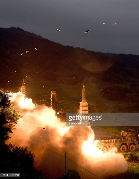 In this handout photo released by the South Korean Defense Ministry South Korea's missile system firing Hyunmu2 missiles into the East Sea during a...