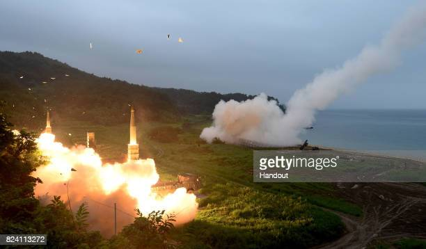 In this handout photo released by the South Korean Defense Ministry US Army Tactical Missile System and South Korea's missile system firing Hyunmu2...