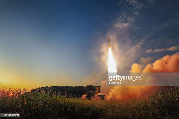 In this handout photo released by the South Korean Defense Ministry South Korea's Hyunmu2 ballistic missile is fired during an exercise aimed to...