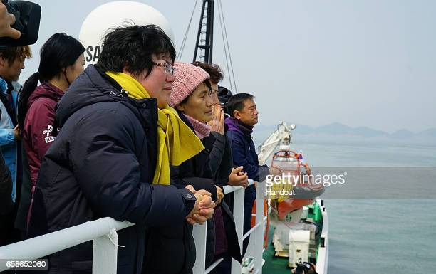 In this handout photo released by the South Korean Ministry of Oceans and Fisheries Lee GeumHui mother of Danwon High student Cho EunHwa who went...