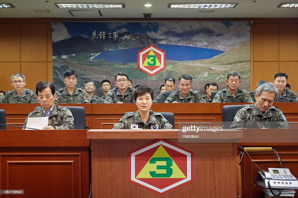 In this handout photo released by the South Korean Presidential Blue House, South Korea's President Park Geun-Hye (C) is seen during her visit to the headquarters of Third Army on August 21, 2015, in Yongin, South Korea. The visit came as military tensions on the divided Korean peninsula soared following a rare exchange of artillery fire on August 20 that put the South Korean army on maximum alert.