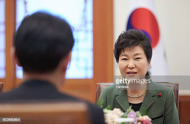 In this handout photo released by the South Korean Presidential Blue House South Korea's President Park GeunHye talks with Japanese Foreign Minister...