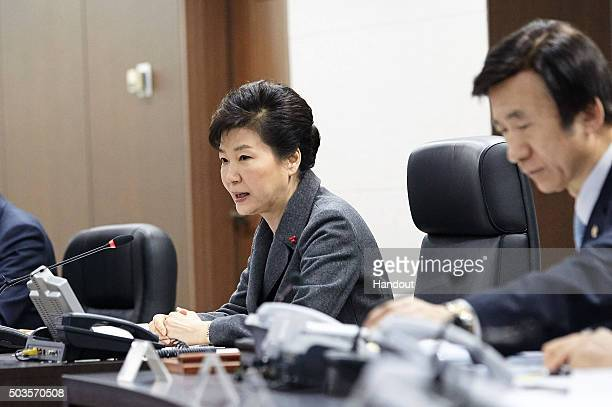 In this handout photo released by the South Korean Presidential Blue House South Korean President Park GeunHye speaking as Foreign MInister Yun...