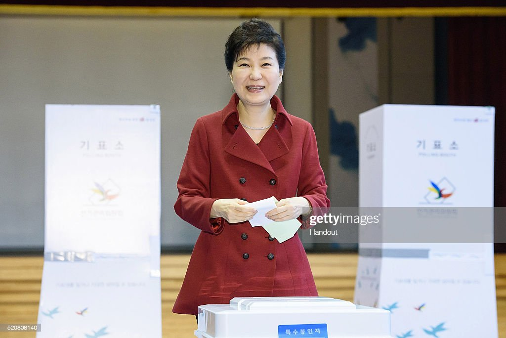 In this handout photo released by the South Korean Presidential Blue House, South Korean President Park Geun-Hye casts her vote in a polling station on April 13, 2016 in Seoul, South Korea. A total of 300 lawmakers will be elected to the four-year term, with 253 of them to be selected through direct elections and the remaining 47 assigned via proportional representation. A total of 944 candidates are competing for the 253 seats.